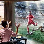 Quiero ver el cine, el futbol y los videojuegos a lo grande: ¿merece la pena un proyector o es mejor una tele de gran formato?