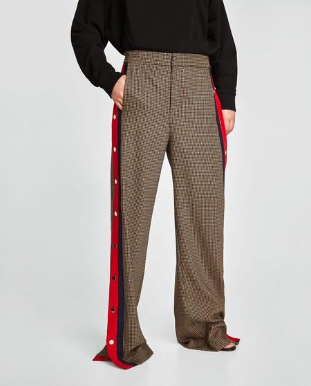 pantalon tachuelas