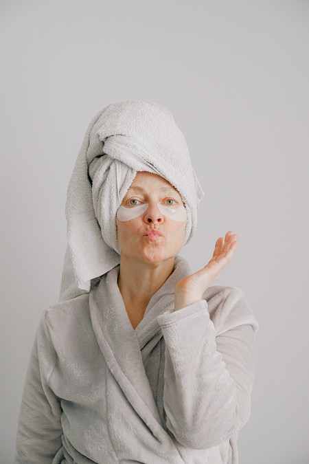 Woman In Gray Bathrobe Pouting 3846156