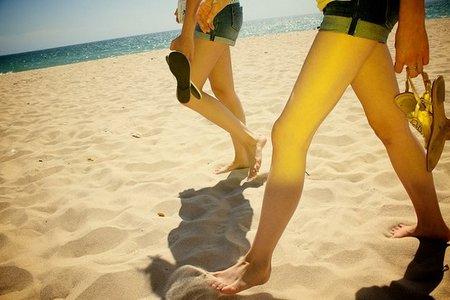 Piernas en la playa - George Schon