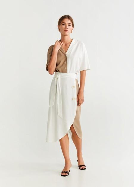 https://shop.mango.com/es/mujer/faldas-midi/falda-denim-desgastado_67084413.html