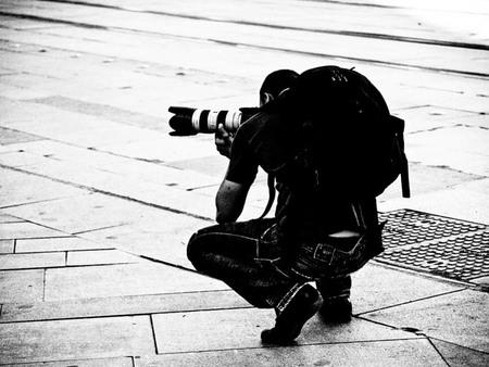 fotografo con mochila