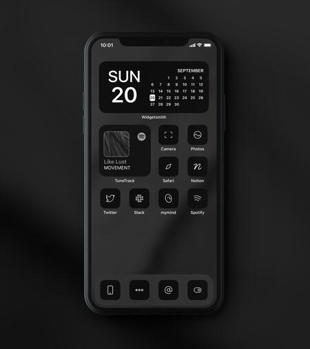 iPhone personalizado con iconos negros y siluetas blancas.