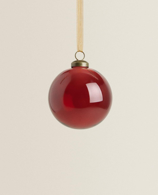 Bola de borosilicato de navidad, con cinta dorada para colgar.