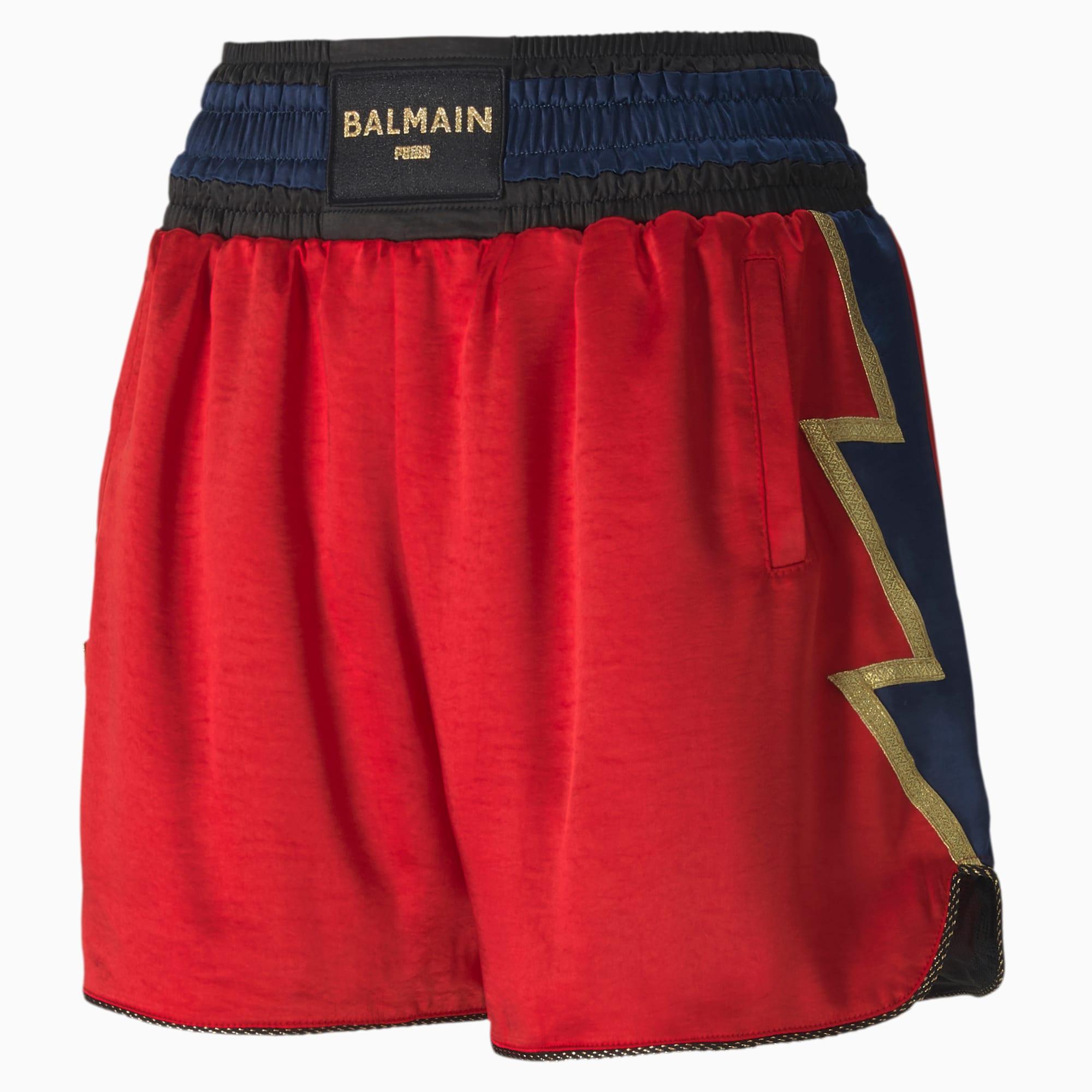 Muestra tu lado más atrevido con estos shorts de boxeo con un material fluido clásico, detalles dorados llenos de glamour y un rayo adornando cada lateral.