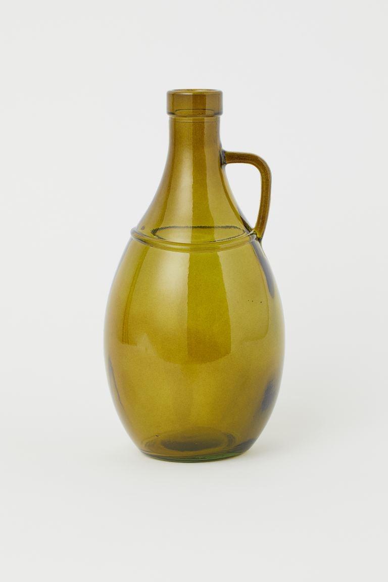 Jarrón botella de vidrio diámetro en el punto más ancho 13 cm, alto 27 cm