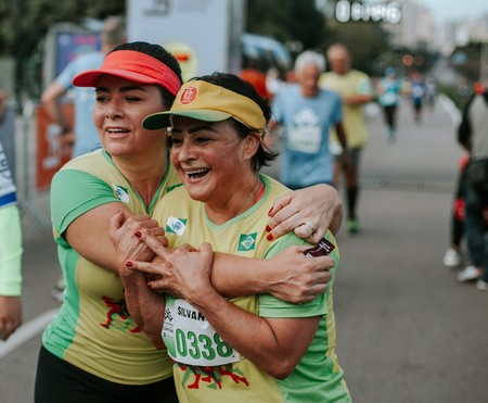 Two Smiling Women Wearing Yellow And Green Shirts 2282586
