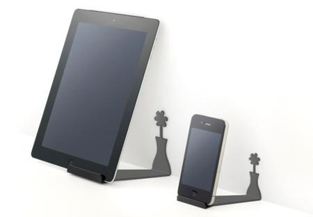 iPad y iPhone que proyectan la sombra de una flor en la pared