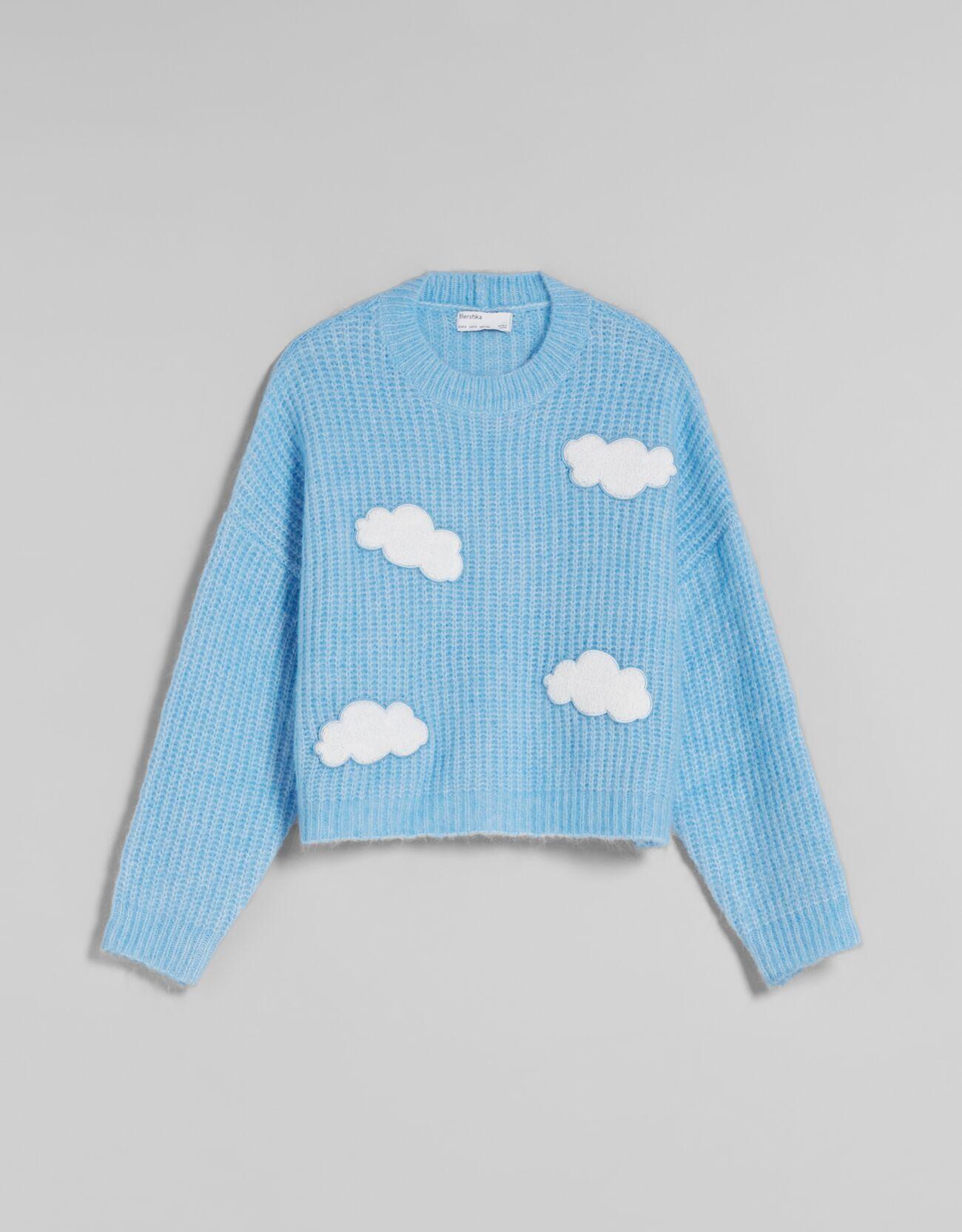 Jersey bordado nubes.