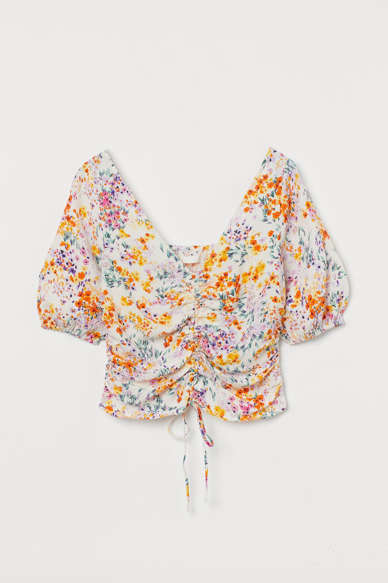 Blusa drapeada con flores