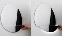 Un espejo con cargador de iPhone incorporado