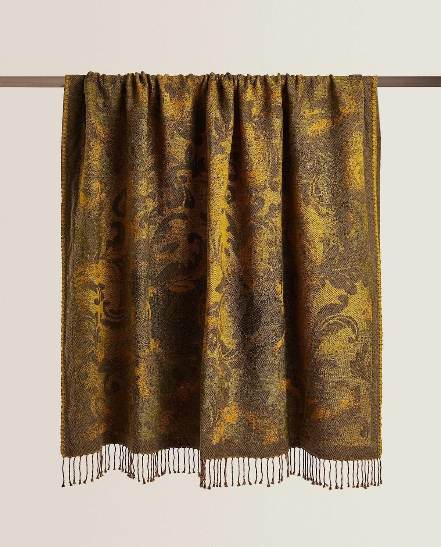 Manta de algodón jacquard con un diseño de dibujo vegetal