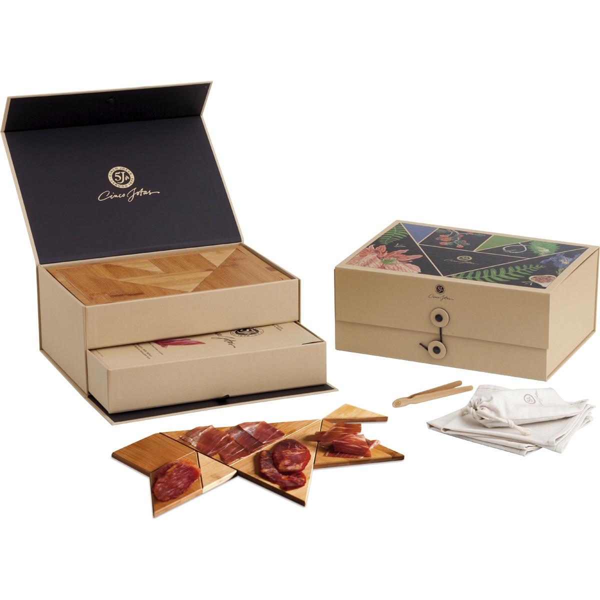 Tangram box 2 blísters de jamón + 2 de presa + 2 de lomo de bellota ibéricos de 80 g c/u estuche 480 g + tabla y juego de Tangram en bambú + 2 servilletas de lino y algodón