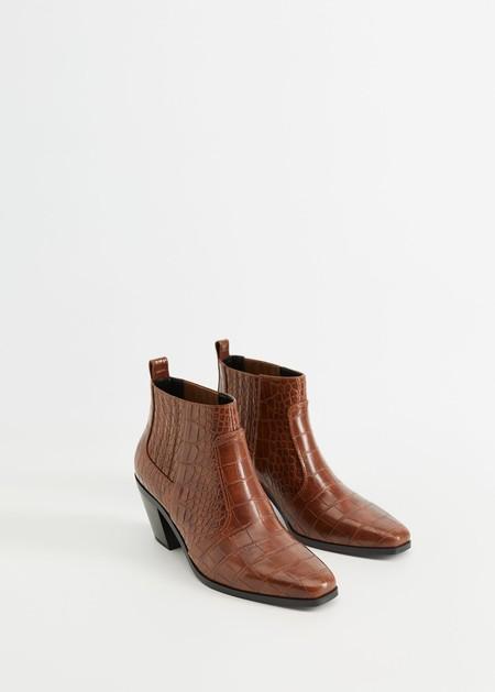 https://shop.mango.com/es/mujer/zapatos-botas-y-botines/bota-piel-cana-alta_67070554.html?c=76&n=1&s=search