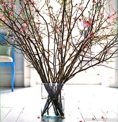 Centro de mesa con ramas