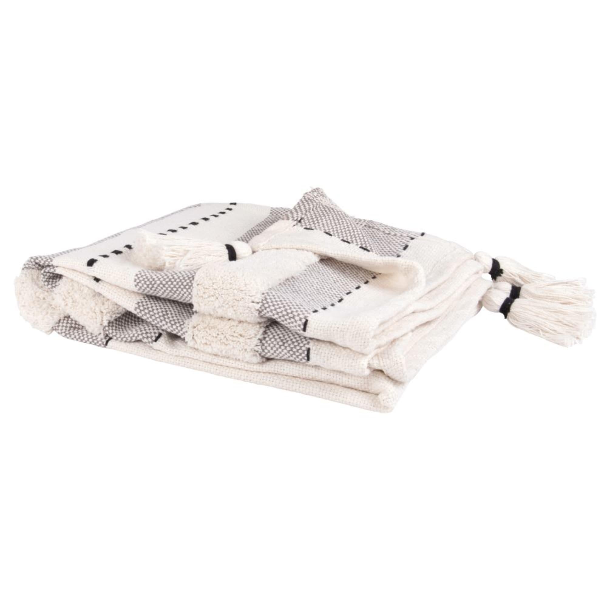 Manta de algodón color crudo con motivos gráficos negros y grises y flecos 130x170