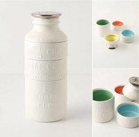Tazas medidoras apilables en forma de botella de leche