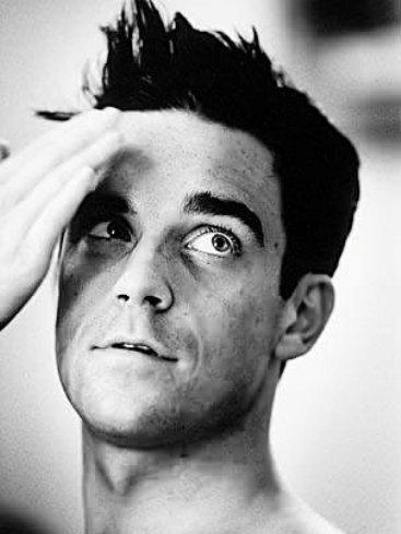 Robbie Williams tiene clara una cosa: no tiene nada claro lo de formar parte de Take That