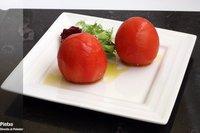 Tomates pera rellenos de cous cous. Receta de Santi Santamaria