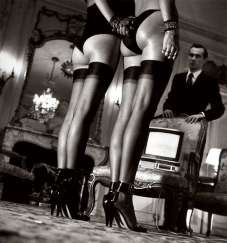 Two Pairs of Legs in Black Stockings