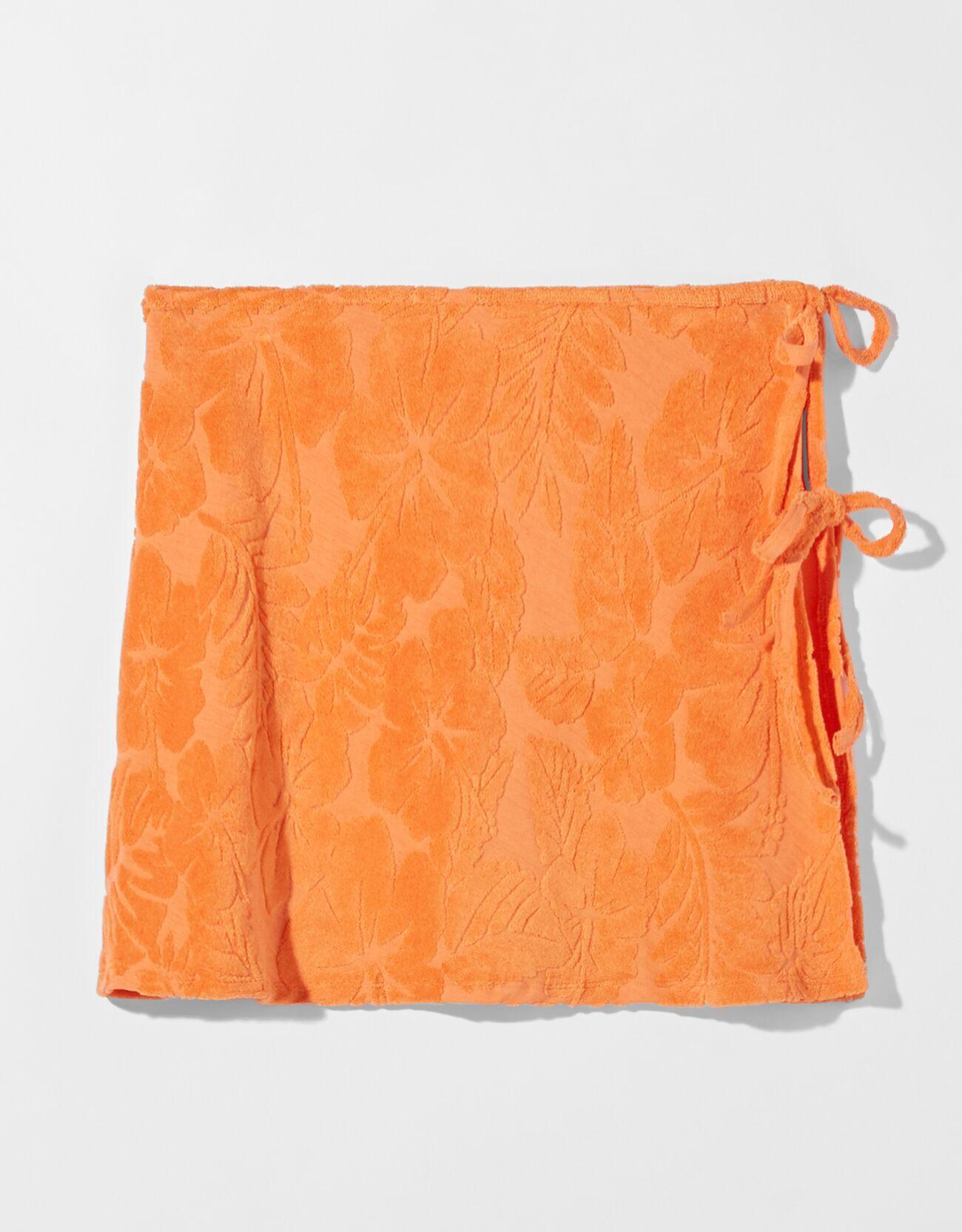 Minifalda con tejido de toalla y aberturas laterales.