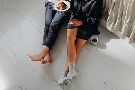 A Couple Having Breakfast On The Floor