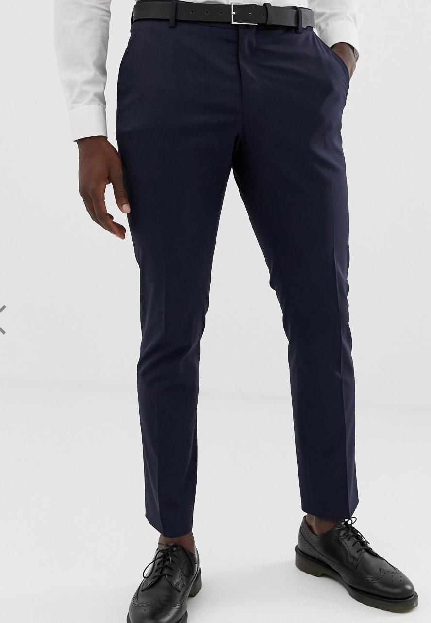 Pantalones de traje de corte slim elástico en azul marino de Selected Homme