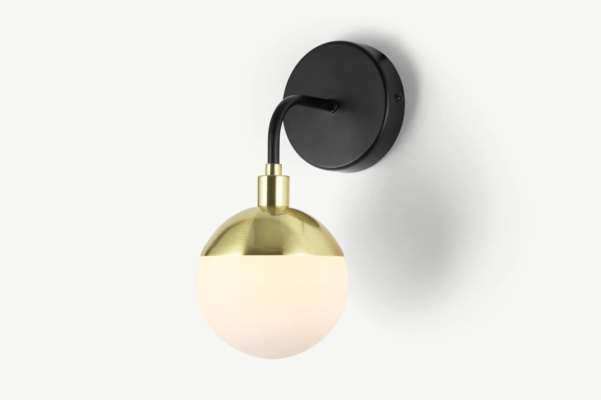 Lámpara Siren de pared para baño, negro y latón cepillado