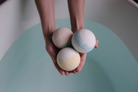 Person Holding Three Bath Balls 374039