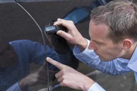 Examining A Car Park Scratch