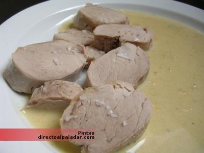 Solomillo de cerdo confitado con salsa de quesos. Receta