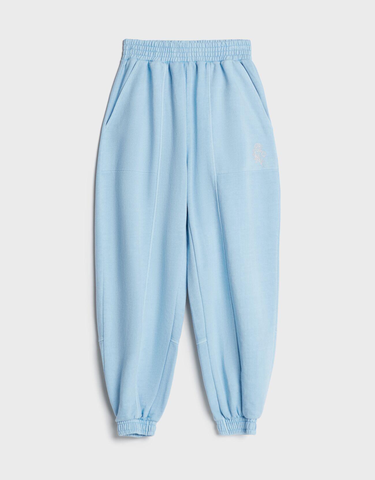Pantalón jogger felpa detalle reflectante.