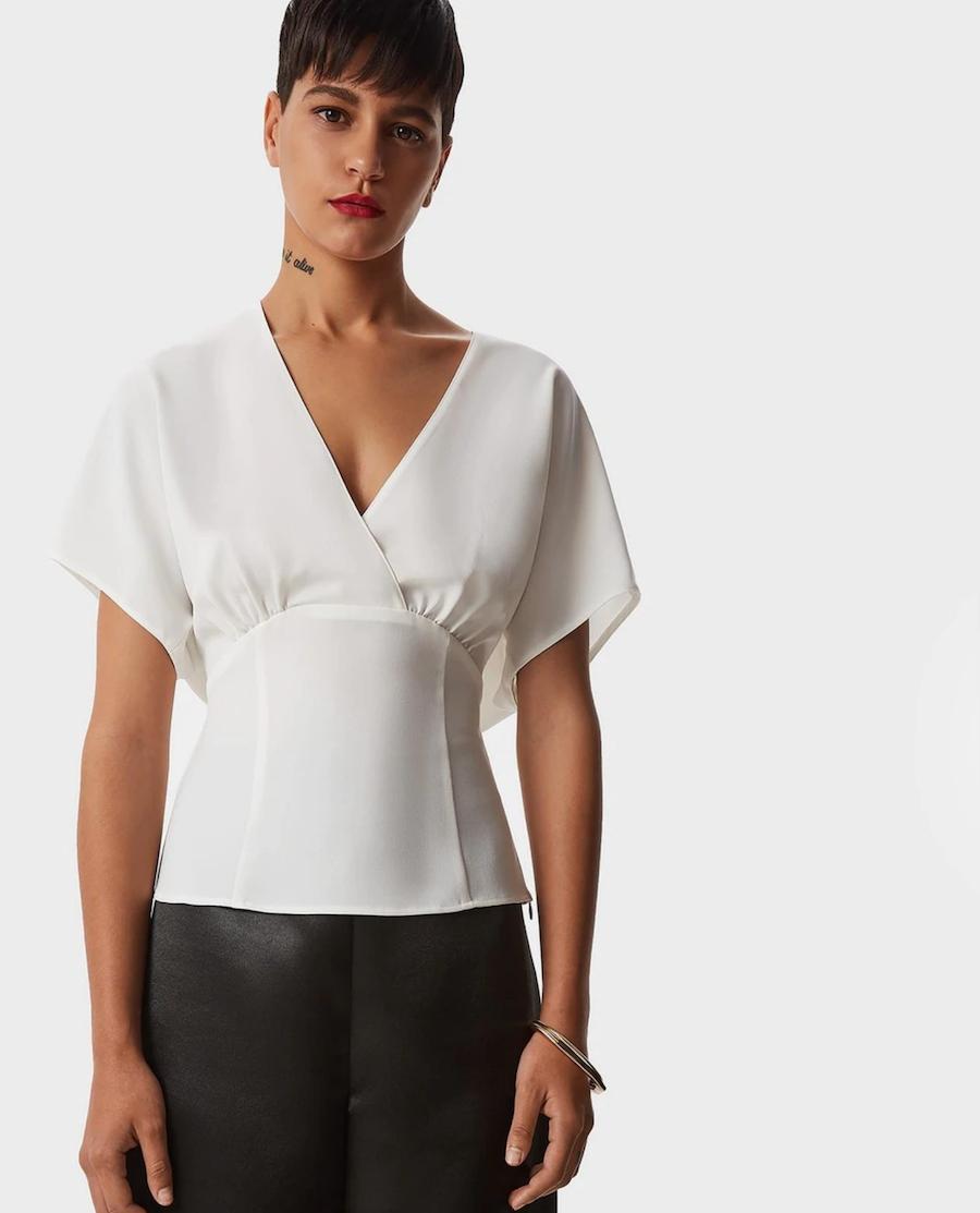 Blusa de mujer liso de manga corta con escote cruzado
