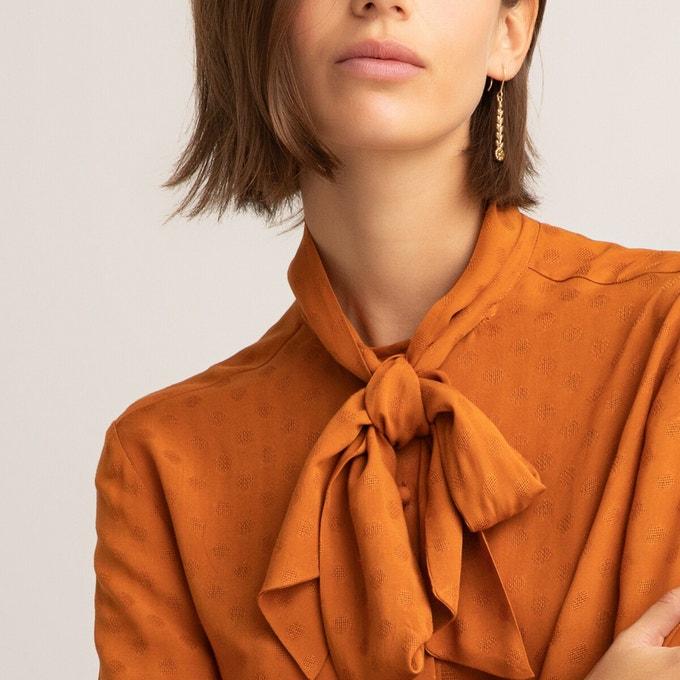 Camisa con lazo en naranja