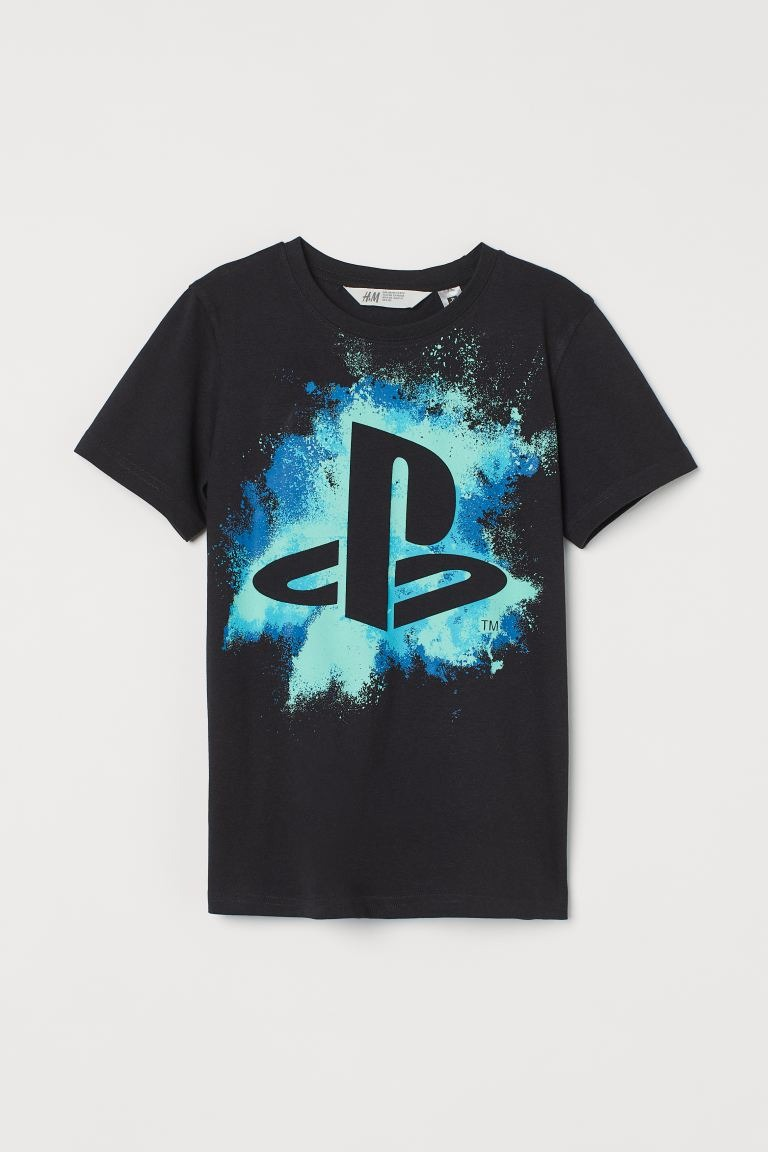 Camiseta infantil en color negro con motivo