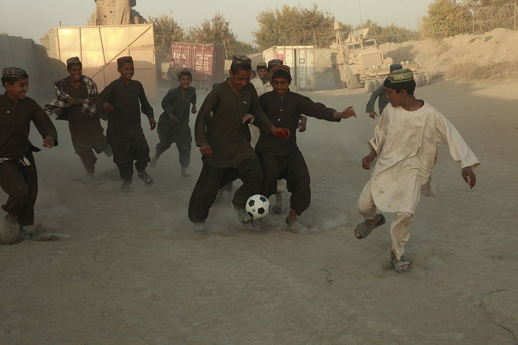 Afghan Boys Play Soccer During A Shura On Patrol Base Mahteen Sangin Afghanistan Nov 4 2011 111104 M Be571 063