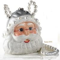 El bolso de esta navidad por Timmy Woods, con Papa Noel de regalo