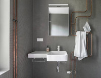 Decorar con las tuberías vistas del baño, una buena idea