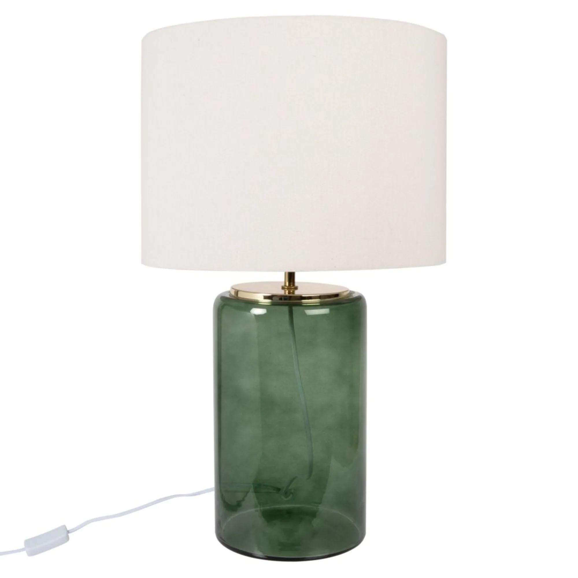 Lámpara de cristal tintado verde con pantalla de lino beige.