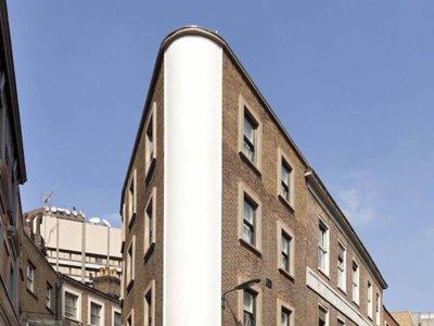 Flatiron House, creando hogar alrededor de una escalera