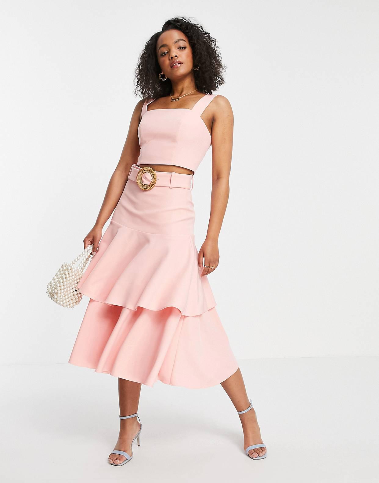 Falda midi con volantes en rosa