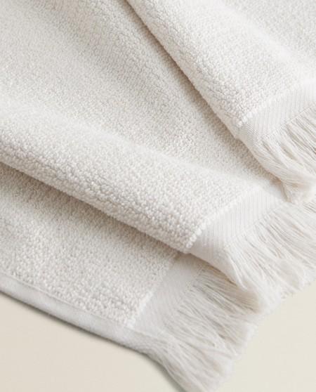toalla de flecos