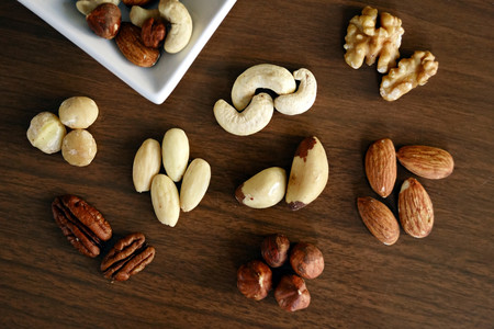 Variety Of Brown Nuts On Brown Wooden Panel High Angle Photo 1295572opt