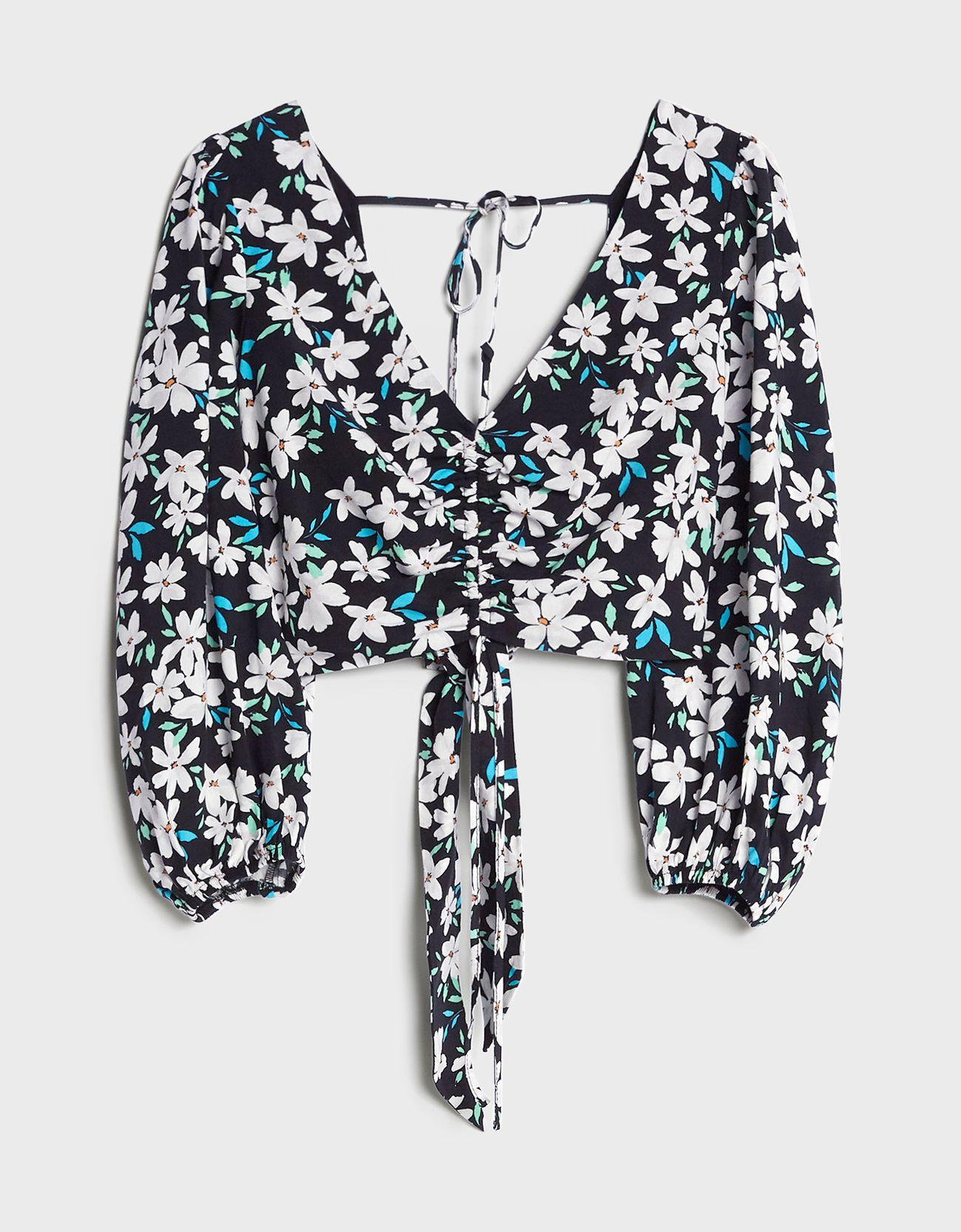 Blusa de estampado floral con nudo.