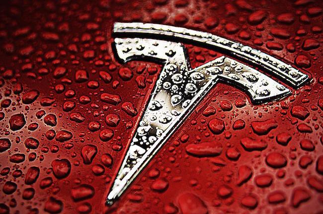 Red Tesla Emblem Logo Water
