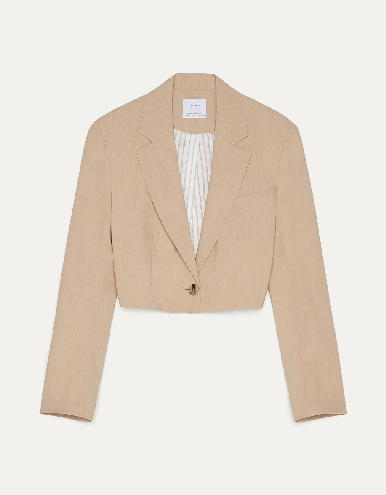 Blazer cropped de color beige.