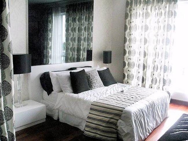 Una buena idea combinar estampados en blanco y negro - Cortinas negras decoracion ...