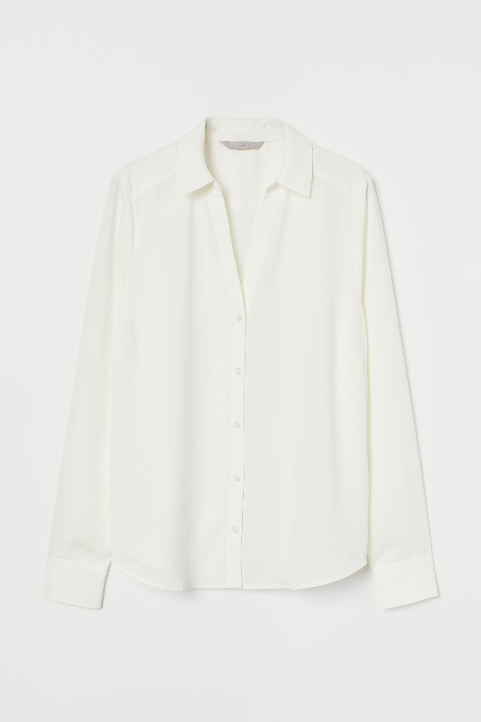 Blusa abotonada con escote de pico