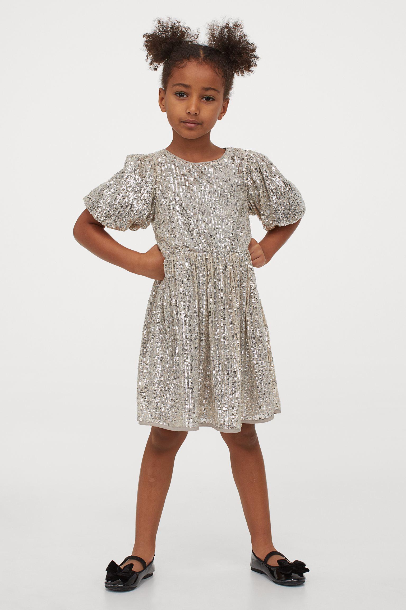 Vestido glitter de niña con mangas abullonadas