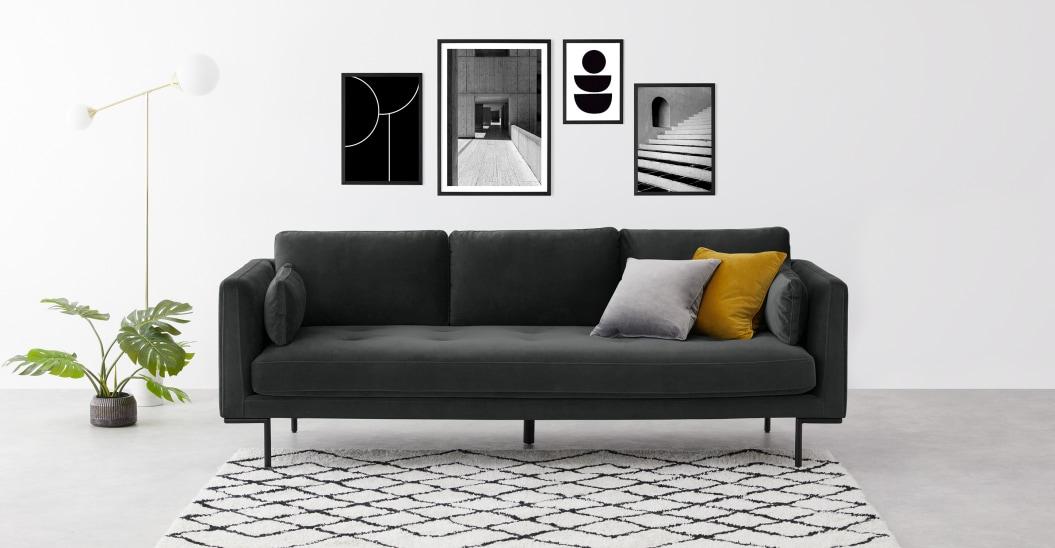 Juego de cuatro láminas de arte en blanco y negro enmarcadas